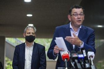 Premier Daniel Andrews addresses the media on Friday as Chief Health Officer Brett Sutton looks on.