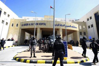 Soldiers stand guard outside Al-Hussein Al Salt Hospital in Salt, Jordan after at least six patients in a COVID-19 ward at the hospital near the capital Amman died due to a shortage of oxygen supplies.