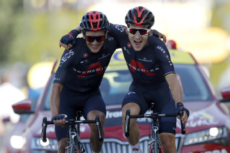 Michal Kwiatkowski, right, celebrates with Richard Carapaz after winning stage 18.