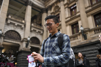 Nepalese international student Sajar Limbu at Melbourne Town Hall on Thursday with some of the vouchers.
