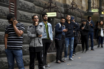 International students queuing outside Melbourne Town Hall on Thursday.