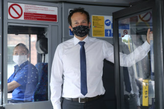 Irish PM Leo Varadkar encourages passengers on a Dublin bus to wear a face mask as some coronavirus lockdown measures were eased.