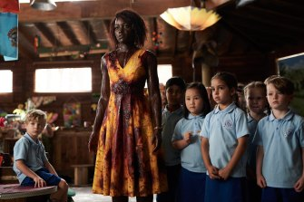 Lupita Nyong'o as Miss Caroline with her kindergarten class in Little Monsters.