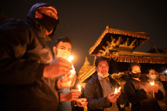 Candlelit vigils for Myanmar's dead have been held across the country and internationally, including this one on March 31 in Kathmandu, Nepal.