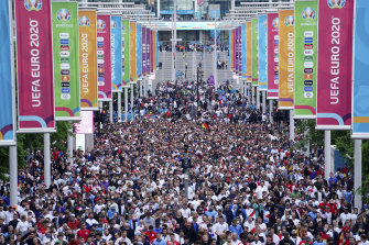 Fans file out of Wembley Stadium after England beat Germany in the round of 16 at Euro 2020.