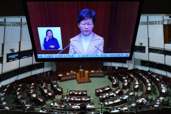 Carrie Lam's image looms over the parliament during a question and answer session.