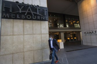 A quarantine worker at the Grand Hyatt tested positive.