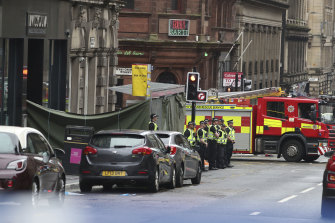 Police remain at the scene of the incident on West George Street in Glasgow.