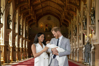 Meghan and Prince Harry pictured with their newborn son in St George's Hall at Windsor Castle in May 2019.