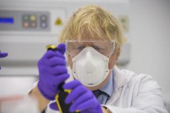 British Prime Minister Boris Johnson visits the lab of French biotechnology firm Valneva in Livingston, Scotland.