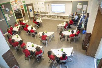 Students return to school in London.