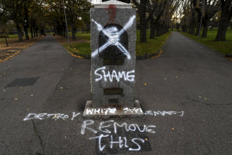 The Captain Cook statue in the Edinburgh Gardens, Fitzroy North has been defaced with phrases including 'Destroy white supremacy'.