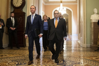 Adam Schiff, left, Jerrold Nadler and other House impeachment managers walk to the Senate chamber on Capitol Hill.