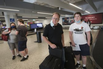David Duncan with his son at Melbourne Airport on Friday morning.