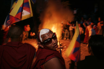Tibetan exiles set fire to Chinese goods in Dharamshala in 2008 after a crackdown by Chinese troops against protests in Tibet.
