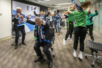 Australian officials and players celebrate in Sydney as FIFA announced Australia and New Zealand would host the 2023 Women's World Cup.