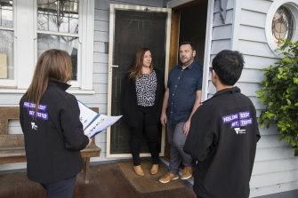 Brimbank residents Sasha and Stephen Torsi talk to community engagement workers on Wednesday.