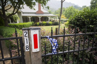 The blue police tape marking Harrietville homes