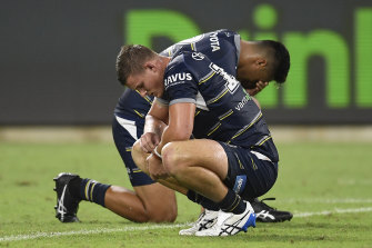 Dejected Cowboys Mitch Dunn and Murray Taulagi after their big loss in Townsville.