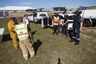 Emergency services gathered on Saturday to pump water out of the Torquay dam near houses.