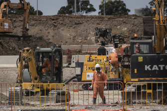 Workers in protective gear at 6 Grand Avenue Camellia, which is a heavily contaminated site that will become the main stabling yard for Parramatta light rail.