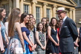 Prince Philip greets guests at the Duke of Edinburgh's Award gold award presentations at Buckingham Palace.