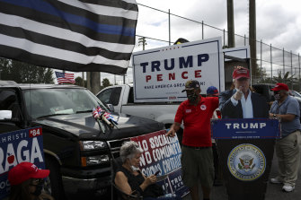 Trump supporters rally outside an early voting booth in Miami, Florida.