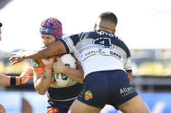 Kalyn Ponga, who had an unhappy homecoming to Townsville, is collected by Esan Marsters.