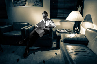 Treasurer Peter Costello looks over his twelfth budget late into the night before Budget Day in 2007.