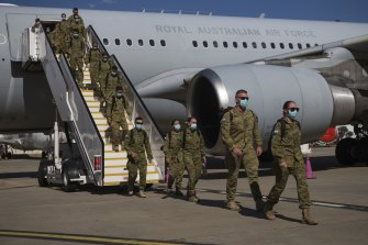 ADF personnel arriving at Tullamarine on Friday afternoon.