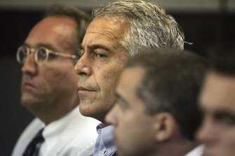 Jeffrey Epstein, centre, pictured in court in 2008.