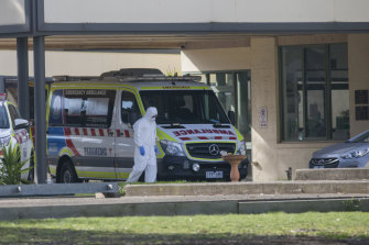 An ambulance at St Basil's Homes for the Aged in Fawkner, where an outbreak has infected 78 people.