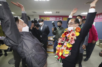 Thae Yong Ho, right, former North Korean diplomat reacts with a supporter after he was certain to secure victory in the parliamentary election in Seoul, South Korea on Thursday.