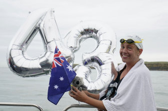 McCardel celebrates after finishing her attempt to swim across the English Channel to equal the world record, currently held at 43 crossings.