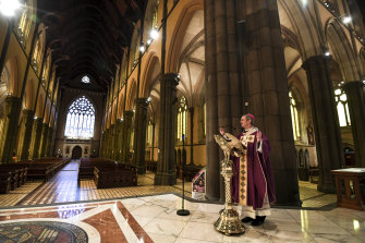 Archbishop Comensoli delivered last year's Easter homily to an empty cathedral.
