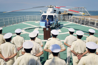 Japanese Prime Minister Shinzo Abe addresses sailors on a tour of a Japanese Coast Guard ship.