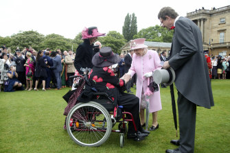 Queen Elizabeth meeting guests at the last Royal Garden Party at Buckingham Palace in May 2019.