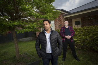 Sean Singh (left) with his neighbour Pete Schipper who performed CPR and saved his life.