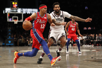 Tobias Harris drives against Wilson Chandler in the 76ers' loss to the Nets.
