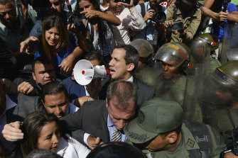 Venezuelan opposition leader Juan Guaido demands National Guard troops step aside and let him and his supporters into parliament.