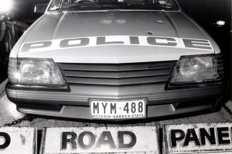 A police car showing bullet holes after officers caught up with Mad Max.