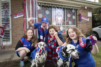 Doggies supporters Mikayla Royal  (right), her sister Mallory and parents Christine and Keith outside their Aspendale home.