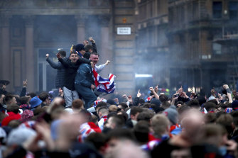 Soccer fans defy pandemic restrictions earlier this month to celebrate Glasgow Rangers winning the Scottish premiership.