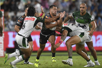 Indigenous All Star Corey Thompson takes on the Maori defence in Townsville last night.