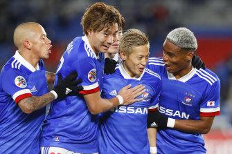 Yokohama F. Marinos celebrate a goal during their rampant win over Sydney FC.