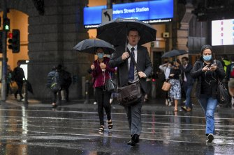Umbrellas were out in force outside Flinders Street Station on Friday.