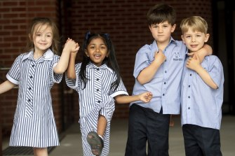 First day: Zoe, Amaira, Elliot and Gideon at Docklands Primary School.