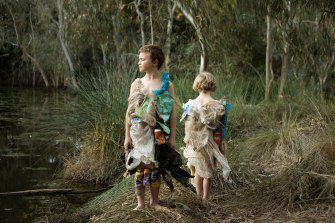Photographer Daisy Noyes makes dresses out of rubbish she collects from Merri Creek. She and her sons Marlow, 6, and Augie, 8, model them by the creek for her photo series on climate anxiety.