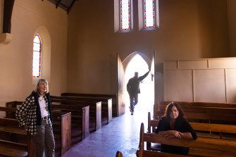 Kaye  Medlyn , Megan Barham and Joe Medlyn (at rear) inside the historic Carapooee church.