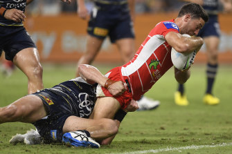 Ben Hunt battles his way to the line for a try.